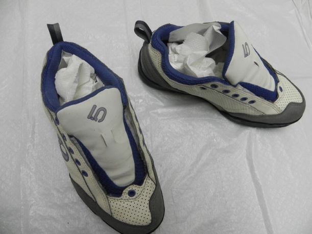 Dry your shoes with paper towel or newspaper in them